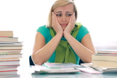 Worried unhappy female student with to much to learn NTSC Stock Footage