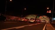 Cars entering tunnel to Geoga Great Bridge in Korea Stock Footage