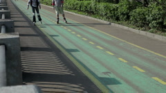 People ride on roller on a sunny day Stock Footage