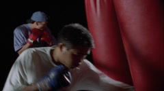 Boxers practice punching on punching bags. Stock Footage