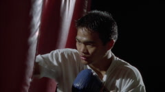 A man hits a punching bag. Stock Footage