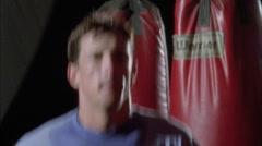 An athlete skips rope in a boxing gym. Stock Footage