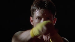 An athlete practices his punches. - stock footage