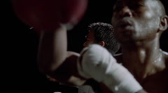 Two boxers working speed bags in slow motion. Stock Footage