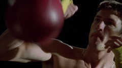 A boxer works out using a speed bag. Stock Footage