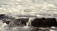 Stock Video Footage of Closeup of Sea Rocks with Waves Crashing