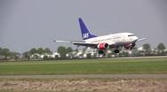 SAS airbus landing at Schiphol Amsterdam Stock Footage