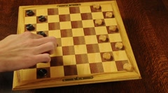 Playing a Game of Checkers Stock Footage