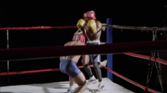 Two boxers exchange punches in the ring. Stock Footage