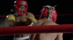 Two men engage in a boxing match. Stock Footage