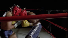 Two boxers fighting in a boxing ring. Stock Footage