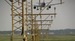Airbus landing with lamp posts in the front - stock footage