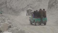 Dusty road, aid transport, Northern Pakistan, news footage Stock Footage