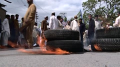 Burning Tires at an Anti American Protest in Abbottabad, Pakistan Stock Footage
