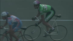 A rider passes another cyclist on a track. Stock Footage