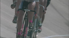 Cyclists race inline on a track. Stock Footage