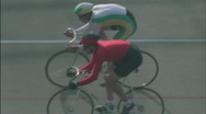 Bicyclists race around a track. Stock Footage