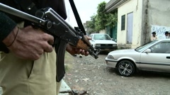 Security Guard outside Osama Bin Laden's House in Abbottabad, Pakistan - stock footage