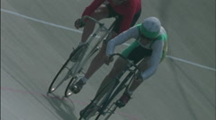 Two men ride bicycles, one smiles and waves with his right arm. Stock Footage