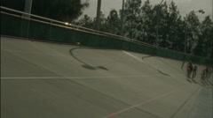 Bicyclists race on a circuit track. Stock Footage