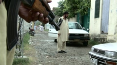 Security Guard outside Osama Bin Laden's House in Abbottabad, Pakistan - stock footage