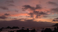 Stock Video Footage of Clouds drifitng across a sunset sky