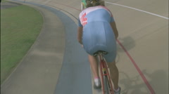 Bicyclists compete on a circuit track. Stock Footage