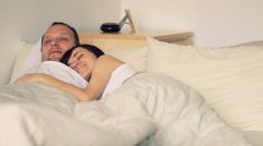 Young couple hugging on the bed in bedroom Stock Footage