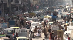 Bazaar and traffic Islamabad Stock Footage