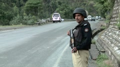 Police Security on Road leading to Abbottabad Stock Footage