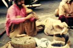 Indian Snake Charmer Street Musician - Old 8mm Film Footage Stock Footage