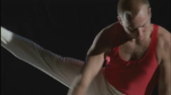 A gymnast performs flairs on the pommel horse. Stock Footage