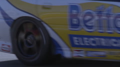A race car speeds down the track. Stock Footage