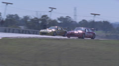Racing cars compete on a circuit track. Stock Footage