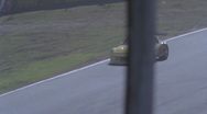 Racing cars race around a track. Stock Footage