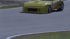 A racing car drives on a circuit track. Stock Footage
