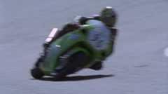 A motorcyclist rounds a turn on a track. Stock Footage