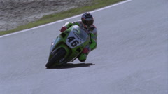 Stock Video Footage of A motorcycle rider approaches a tight corner.
