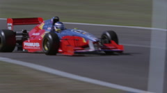 A race car speeds between two turns. - stock footage
