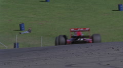 Race cars travel around a track. Stock Footage