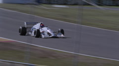A formula car drives on a circuit track. - stock footage