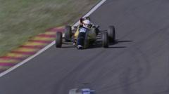 Formula cars racing on a circuit. - stock footage