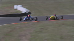 Two children race little cars. Stock Footage