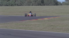 A lone race car speeds in and out of tight corners. Stock Footage