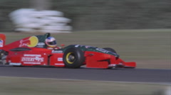 Formula car driving on a circuit. - stock footage