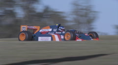 A race car moves swiftly down a track. Stock Footage