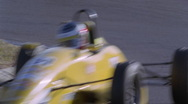 A race car accelerates out of hair pen turn. Stock Footage
