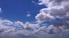 peaceful backlit time lapse clouds against a deep blue sky - stock footage