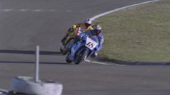 Motorcycles compete on a racing track. Stock Footage