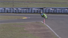 A motorcyclist races around a track. Stock Footage